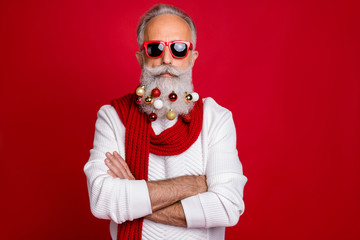 Portrait of cool retired business man with eyeglasses eyewear crossing his hands wearing white sweater isolated over red background