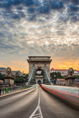 Foto op Canvas Boedapest Budapest, Hungary - The iconic Szechenyi Chain Bridge at sunset with amazing sky and heavy afternoon traffic