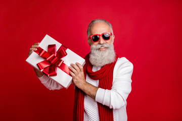 Cool aged santa like man came meeting newyear with large giftbox wear sun specs knitted jumper...