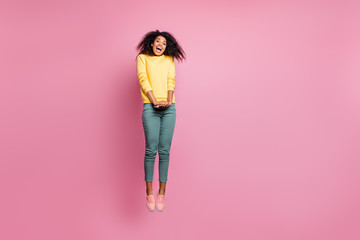 I love shopping concept. Full length photo of pretty adorable sweet amazed surprised hipster teen girl jumping up screaming to you wearing sweatshirt isolated pastel color background