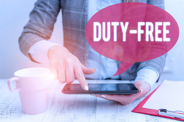 Text sign showing Duty Free. Business photo showcasing Store or establisbhement that sells imported products witout tax Business woman sitting with mobile phone and cup of coffee on the table