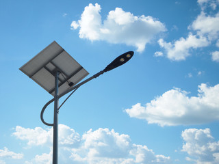 solar street light lamp post led with panel system and blue sky and white clouds using for background energy saving concept. Fotomurales