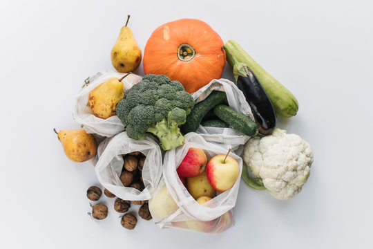 Fresh groceries in eco cotton bags, zero waste shopping concept. Vegetables from market in reusable bags