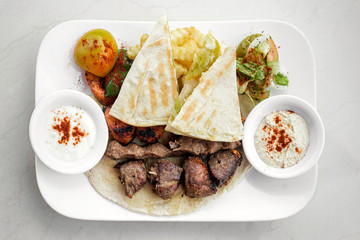 lebanese meshwi mixed grilled meat set on plate