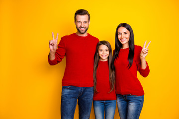 Photo of charming cheerful nice happy joyful mom dad daughter showing you v-sign wearing jeans red...