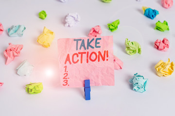 Conceptual hand writing showing Take Action. Concept meaning do something official or concerted to achieve aim with problem Colored crumpled paper empty reminder white floor clothespin