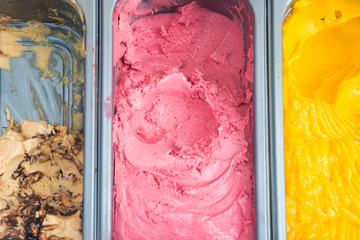 Several gelato ice cream with mixed fruit flavors in a store tray