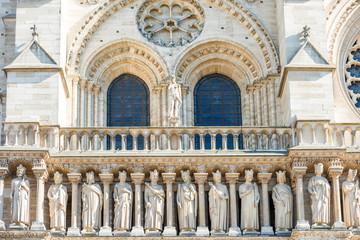 Architectural details on facade of famous cathedral Notre-Dame de Paris. Paris, France before fire April 15, 2019