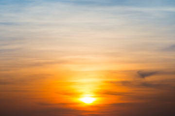 Beautiful sky and clouds with orange dramatic sunset. Can be used as abstract or nature background