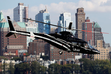 A helicopter operated by Uber Copter, a new service by the ride-sharing company Uber, takes off from Manhattan in New York