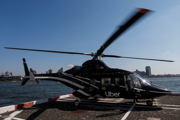 A helicopter operated by Uber Copter, a new service by the ride-sharing company Uber, in Manhattan in New York
