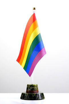 LGBT rainbow flag. Desktop symbol of sexual minorities. The concept of an official meeting of gays and lesbians.