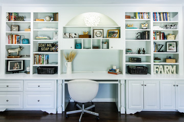 Indoor home office with desk and built in wood shelving