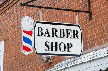 Closeup of a Barber shop sign with Barber Pole
