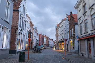 Fototapete - Streets in the old town of Bruges in the evening. Street light.