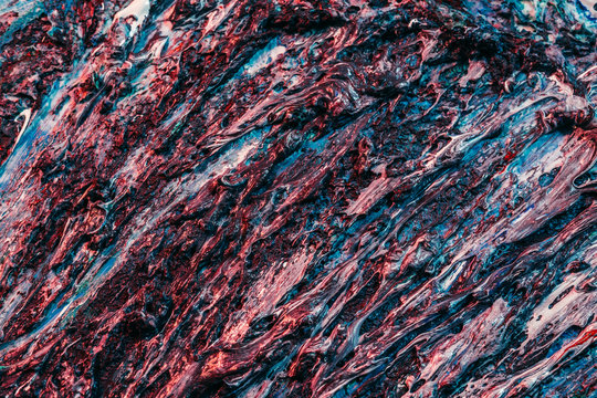 Abstract art background. Blue and red wet acrylic paint mix. Tree roots texture design.