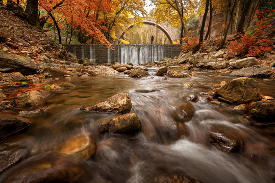 Beautiful autumn landscape.The old stone bridge of Palaiokarya and the waterfall! Trikala prefecture, Thessaly, Greece