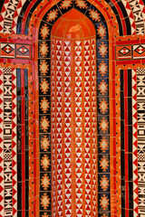Red mosaic ornament decoration background, Eastern ethnic oriental texture. Muscat, Oman. Sultan Qaboos Grand Mosque