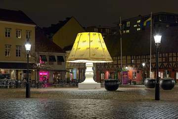 Giant Lamp at Lilla Torg Square with Christmas illumination in night on December 13, 2015 in Malmo, Sweden