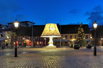 Giant Lamp at Lilla Torg Square with Christmas illumination in dusk on December 13, 2015 in Malmo, Sweden