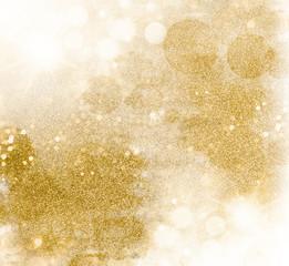 Golden glittering pattern. Festive background of shiny shimmering sparkles
