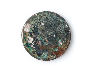 Old rusted coin,Oxidized old coin on white background.