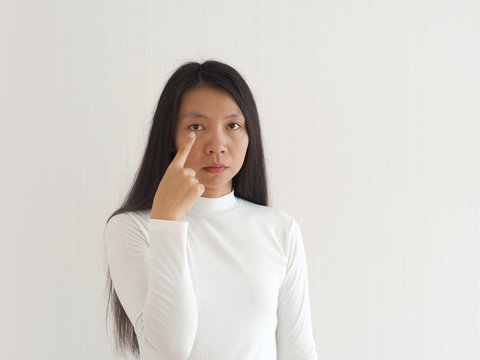 color blindness in asian woman, cause of light sensitive cells in retina fail to respond appropriately to variations in wavelengths of light enable see an array of colors using for health eye concept.