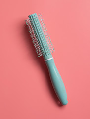 Round comb closeup on pink background