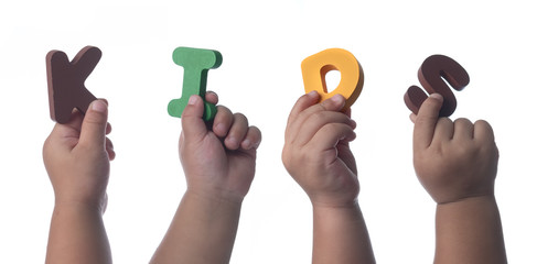 Kids hands holding colorful alphabet letters ,The Word KIDS