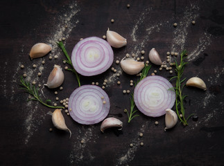 Red onion, garlic,rosemary and pepper on wood background,top view