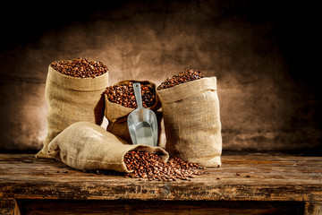 Wall Murals Cafe Fresh old sack of coffee grains and brown old wall background