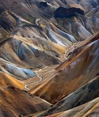 Zelfklevend Fotobehang Diepbruine River along a Valley in Landmannalaugar among colorful mountains, Iceland