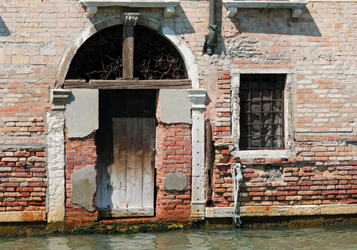 old door on the canal in Venice
