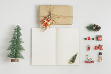 Handmade Gift box and notebook mock up with christmas ornaments on white  background