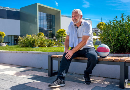 Senior man having a knee injury after recreation