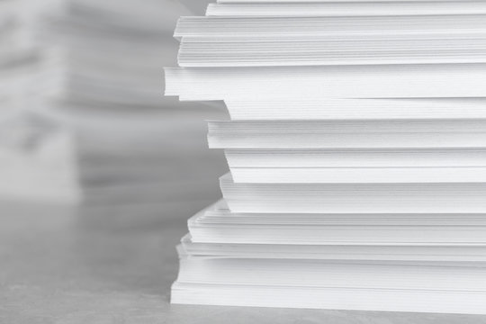 Stack of blank white paper on table, closeup. Space for text