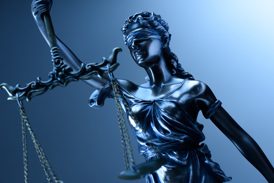 Statue of justice on blue background