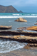 Rocks of all sizes with the ocean and sky in the background, on an overcast day, at the Los Frailes Beach National Park, Manabi, Ecuador