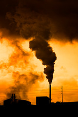 Pollution and smoke from chimneys of factory or power plant environment dirty