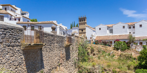 Fototapete - Panorama of the old bridge and church tower of Ronda, Spain
