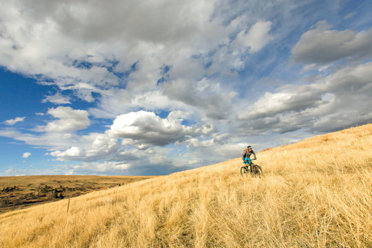 One man mountain biking on singletrack trails outside of Boulder, Colorado.
