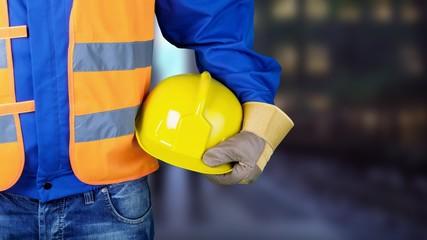 Worker man with helmet on background