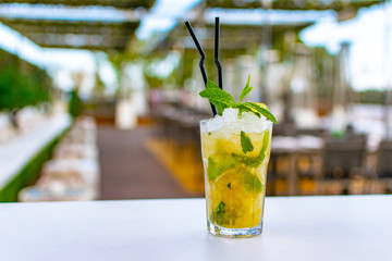 a chilled lime green mojito cocktail