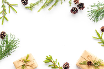New Year frame with fir branches and present box mockup on white background top view space for text