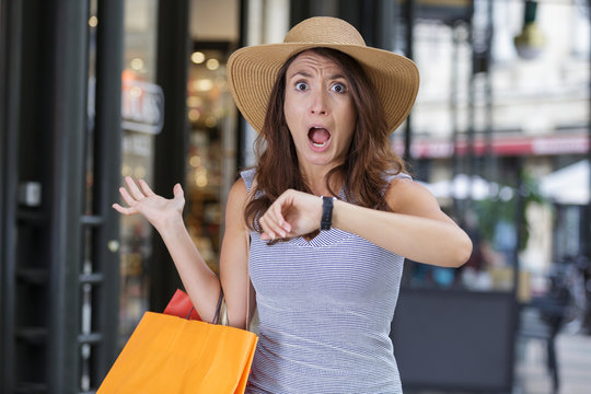stressed young woman with shopping bags
