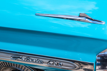 A classic blue Ford Galaxie 500 emblem and styling.