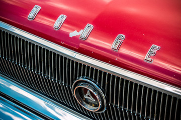 A Dodge nameplate on the front of a classic muscle car, a Dodge Coronet or similar from the late 60's to early 70's.