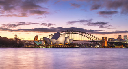 Sydney Harbour Skyline and Bridge panorama, NSW, Australia, Oceania, with dramatic colourful light at twilight sundown.