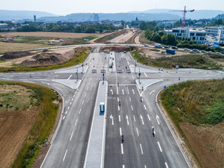 Aerial photograph of road cross under construction. building new streeet area connection Viewpoint from above