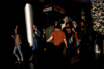 """People are seen outside the TCL Chinese Theatre as the film """"Joker"""" premieres in Hollywood"""